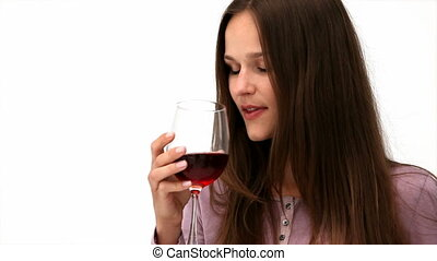 Happy woman drinking a glass of red wine