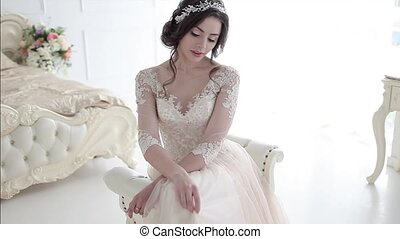 Portrait of beautiful girl in a luxurious wedding dress....