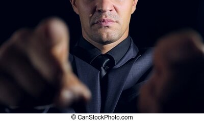 super close-up of a man in black clothes on a black...