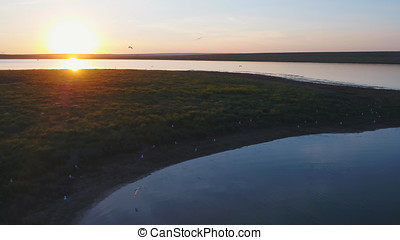 Aerial view of beautiful emerald green water lake and summer landscape sunset. Sunset on the lake