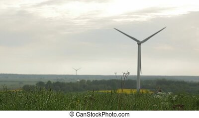 wind turbines isolated on overcast sky background - few wind...