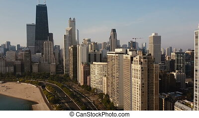 Aerial view of the beautiful Chicago cityscape. Drone t flying away from skyscrapers and Michigan lake, acceleration.