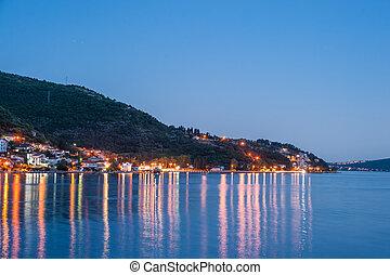 Evening at Boka Kotorska bay with lanterns, travel...