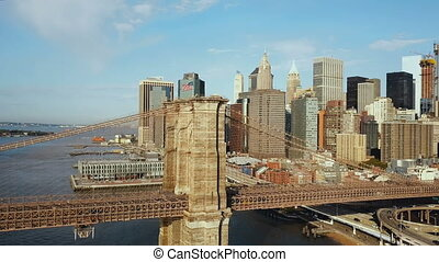 Aerial view of the Brooklyn bridge through East river to...