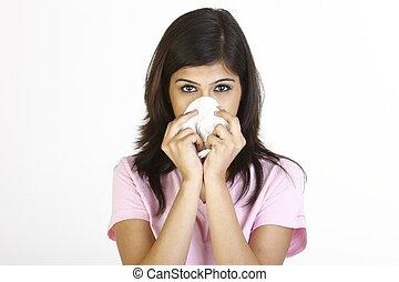 girl sneezing in tissue paper