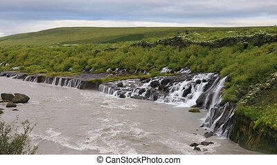 Hraunfossar waterfall in Iceland - Hraunfossar waterfall...