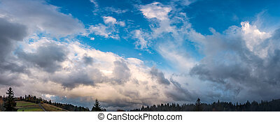 gorgeous cloudscape over the forest on hills. beautiful...