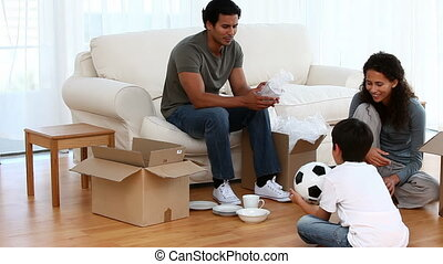 Family playing during removal sitting in a living room