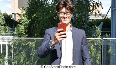 Young man in city taking photos with cell phone - Handsome...
