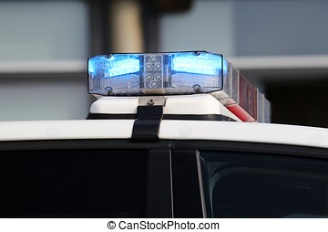 emergency vehicle lighting - police car with active blue...