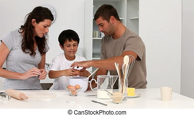 Cute family cooking biscuits  in the kitchen