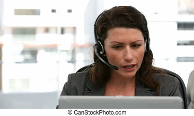 Angry representative on the phone in a call centre