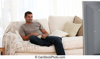 Man watching tv interupting by wife - Man watching tv...