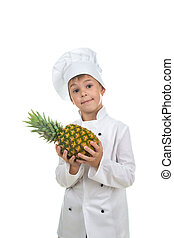 Handsome boy wearing chef uniform holding ananas. - Handsome...