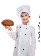 Happy cute boy in chef uniform holds a fresh bread, isolated...