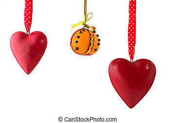 Hanging hearts and orange with cloves for Christmas
