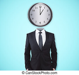 Punctual concept - Clock headed businessman standing on blue...