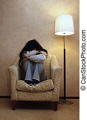 depressed woman - A depressed woman with a closed position