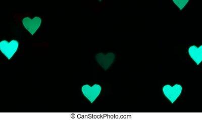 blinking heart shaped light bokeh background.