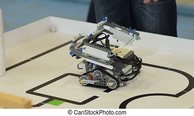 Robot path challenge - Close-up shot of robot made by a...