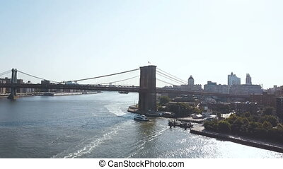 Aerial view of the Brooklyn bridge through the East river...