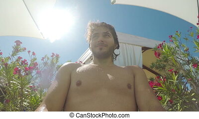 POV point of view with guy running and jumping into the pool...