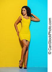 blue and yellow - Beauty, fashion shot. Beautiful slender...