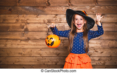 funny child girl in witch costume in halloween - Laughing...