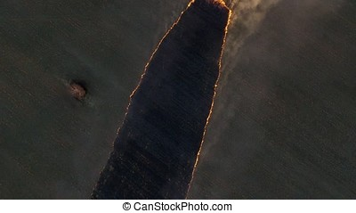 Aerial view. Footage. Fire in the Cornfield After Harvest....