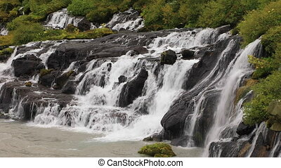 View of Hraunfossar waterfall in Iceland close-up