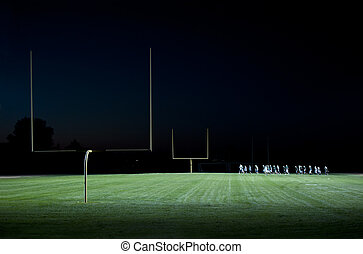 high school foot ball practice on the field - football...