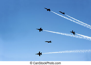 jet planes going off formation in the sky - fighter jets...