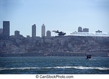 us navy jet fighters fly low over the city of san francisco