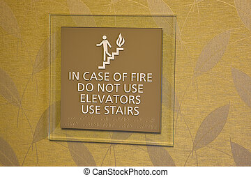 In case of fire dont use elevator - warning sign in a...