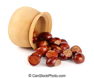 chestnut in a wooden bowl isolated on white background...
