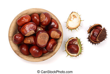 chestnut in a wooden bowl isolated on white background. Top...