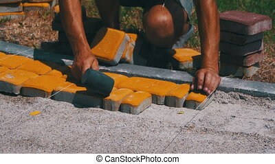 Worker Laying Stone Paving Slab Laying Paving Slabs by...