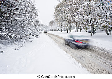 Road in deep Winter snow with blurred moving cars - Road...