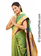 woman in namaskaram pose - Woman in green silk-sari with...