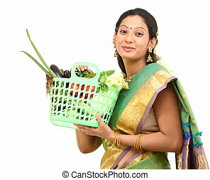 Woman with basket full of vegetable