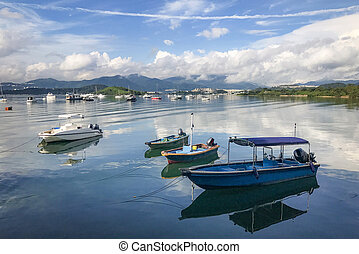 mountain, blue sky, boats, yacht and sailboats on lake -...