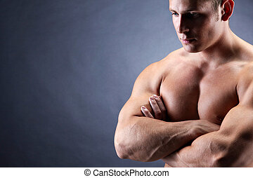 Symbol of strength - Image of shirtless man with crossed...
