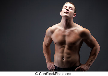 Athlete - Image of shirtless man in jeans posing in front of...