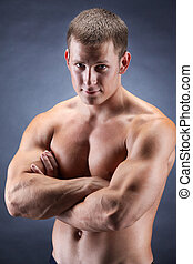 Handsome bodybuiler - Image of shirtless man with crossed...