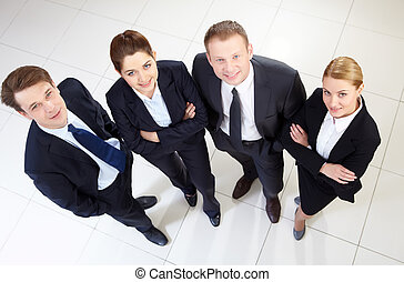 Companions - Image of confident business team looking at...