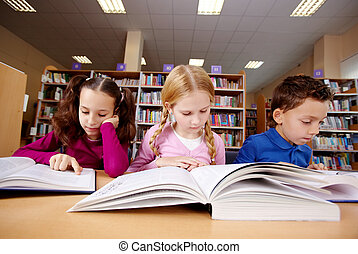Reading book - Portrait of pupils looking at pages of...