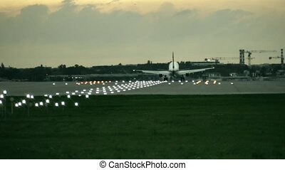 Twin engine commercial airplane landing at the airport in...
