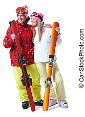 Happy skiers - Portrait of happy couple with skis in hands...