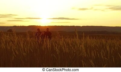 two tourists silhouettes. two tourists go at nature sunset....