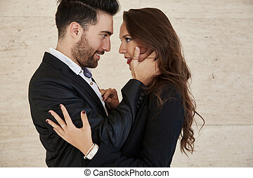 Elegant couple embracing looking at each other